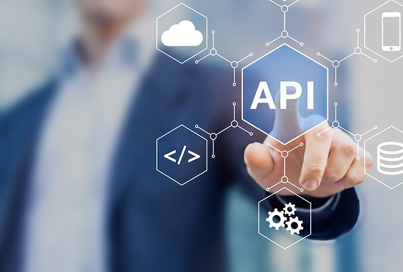 Man touching a honeycomb design with API written in the center