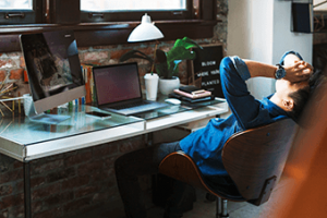 Stressed out developer taking a break while resting hands on head